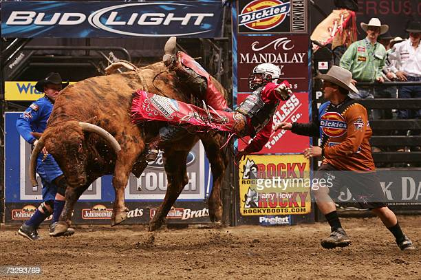 Travis Briscoe attempts to ride Hot Rod during the final of the PBR Amp'd Mobile Invitational in the 2007 Professional Bull Riders Built Ford Tough...