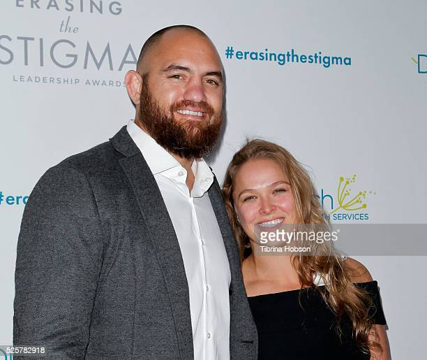 Travis Browne and Ronda Rousey attend the 20th anniversary of 'Erasing The Stigma Leadership Awards' at The Beverly Hilton Hotel on April 28 2016 in...