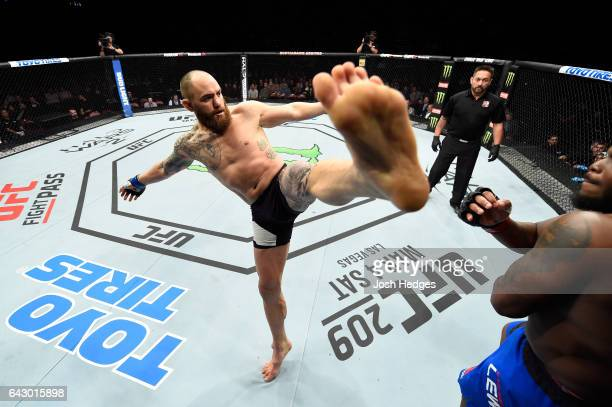 Travis Browne kicks Derrick Lewis in their heavyweight fight during the UFC Fight Night event inside the Scotiabank Centre on February 19 2017 in...
