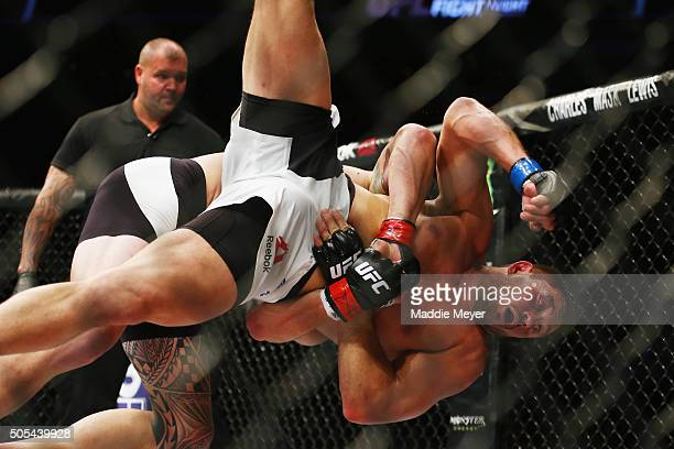 Travis Browne picks up Matt Mitrione in their heavyweight bout during UFC Fight Night 81 at TD Banknorth Garden on January 17 2016 in Boston...