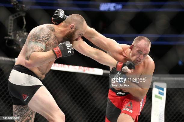 Travis Browne punches Aleksei Oleinik in their heavyweight bout during the UFC 213 event at TMobile Arena on July 9 2017 in Las Vegas Nevada