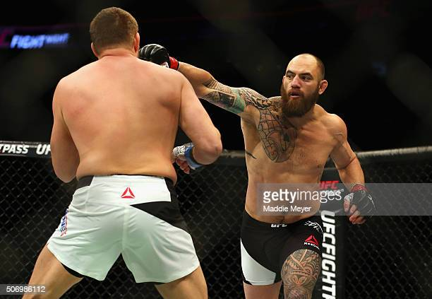 Travis Browne punches Matt Mitrione in their heavyweight bout during UFC Fight Night 81 at TD Banknorth Garden on January 17 2016 in Boston...