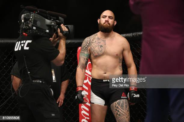 Travis Browne stands in the Octagon prior to his lightweight bout against Aleksei Oleinik in their heavyweight bout during the UFC 213 event at...