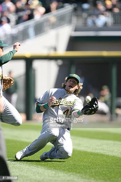 Travis Buck of the Oakland Athletics dives for a fly ball during the game against the Chicago White Sox at US Cellular Field on Jackie Robinson Day...