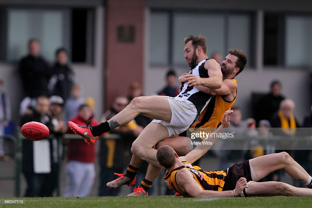 Travis Cloke of Collingwood Magpies gets tackled right in front goals during the round 20 VFL match between the Box Hill Hawks and the Collingwood Magpies at Box Hill City Oval on August 20, 2016 in Melbourne, Australia.
