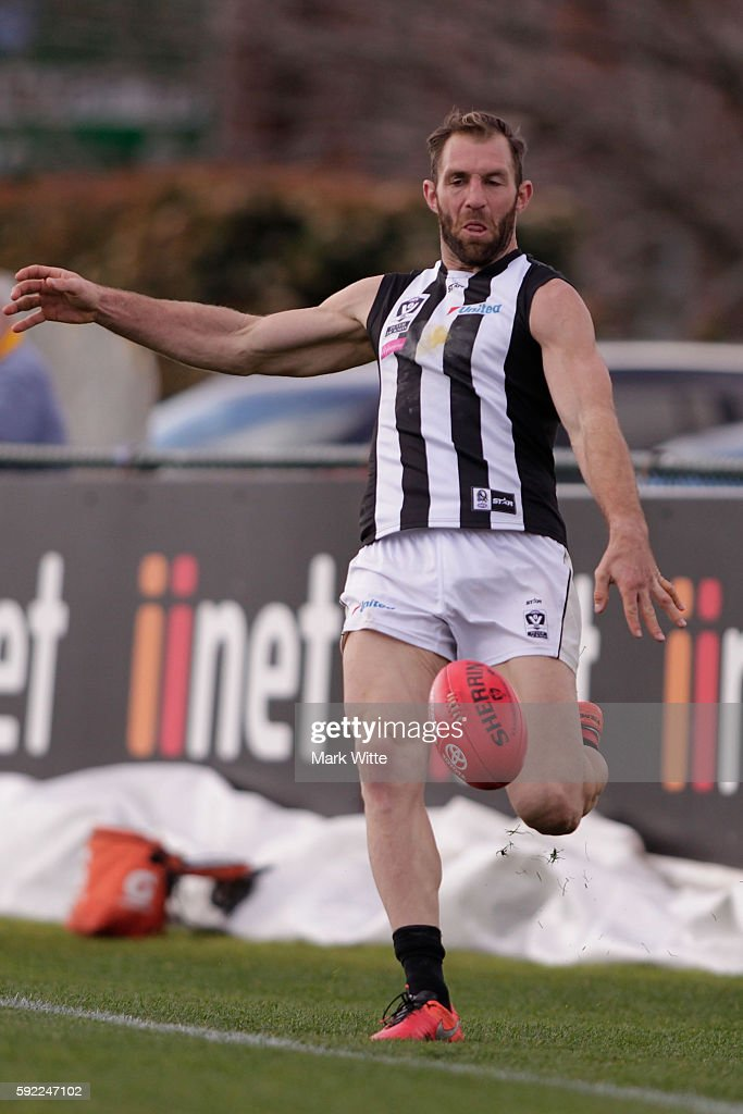 Travis Cloke of Collingwood Magpies kicks the ball during the round 20 VFL match between the Box Hill Hawks and the Collingwood Magpies at Box Hill City Oval on August 20, 2016 in Melbourne, Australia.
