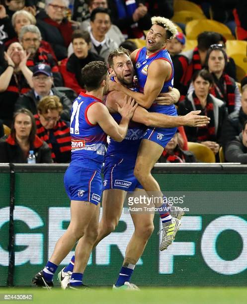 Travis Cloke of the Bulldogs celebrates a goal with Jason Johannisen of the Bulldogs during the 2017 AFL round 19 match between the Western Bulldogs...