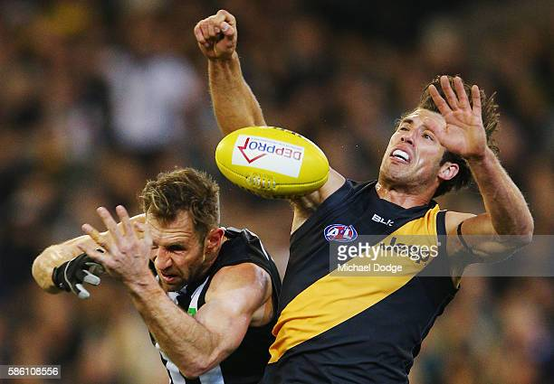 Travis Cloke of the Magpies and Alex Rance of the Tigers compete for the ball during the round 20 AFL match between the Richmond Tigers and the...