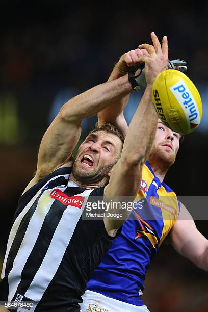 Travis Cloke of the Magpies and Jeremy McGovern of the Eagles compete for the ball during the round 19 AFL match between the Collingwood Magpies and...