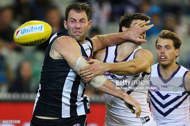 Travis Cloke of the Magpies and Sam Collins of the Dockers compete for the ball during the round 14 AFL match between the Collingwood Magpies and the...