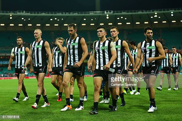 Travis Cloke of the Magpies and team mates look dejected after losing the round one AFL match between the Sydney Swans and the Collingwood Magpies at...