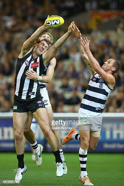 Travis Cloke of the Magpies attempts to mark infront James Kelly of the Cats during the round three AFL match between the Collingwood Magpies and the...