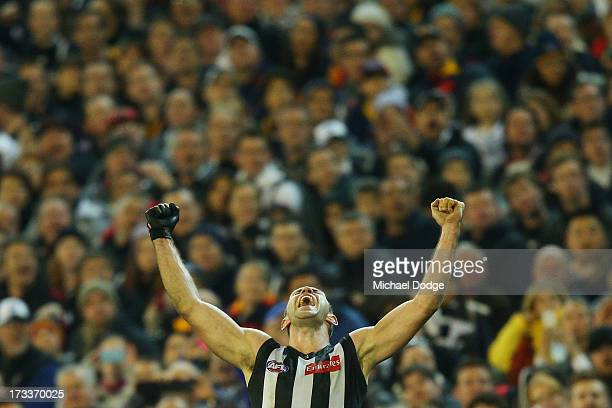 Travis Cloke of the Magpies celebrates a goal during the round 16 AFL match between the Collingwood Magpies and the Adelaide Crows at Melbourne...
