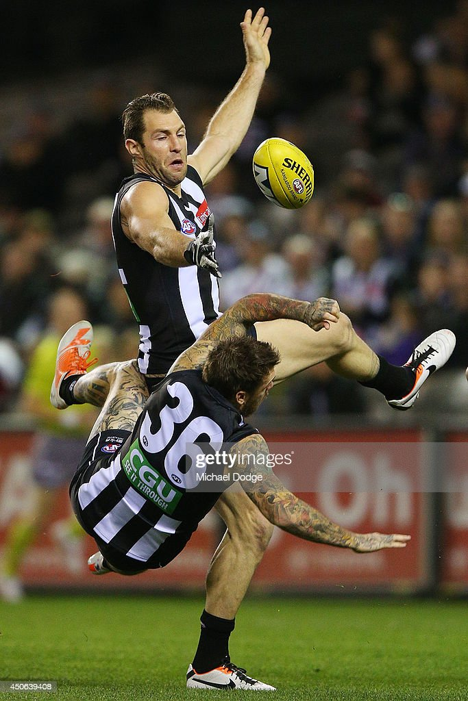 Travis Cloke of the Magpies collides with Dane Swan (L) of the Magpies during the round 13 AFL match between the Collingwood Magpies and the Western Bulldogs at Etihad Stadium on June 15, 2014 in Melbourne, Australia.