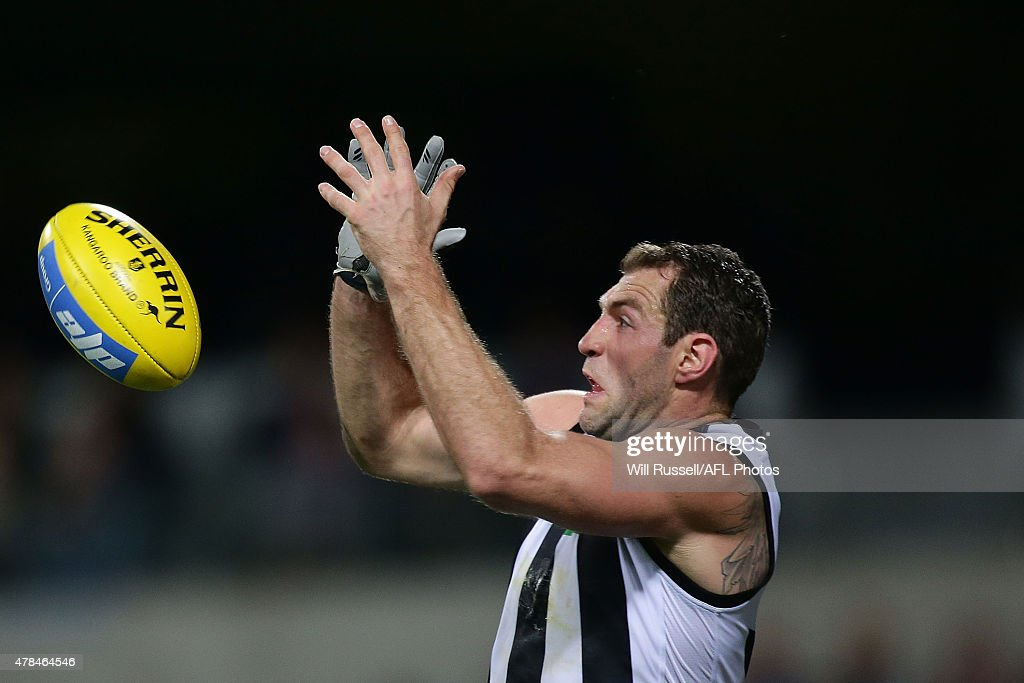 Travis Cloke of the Magpies goes for the mark during the round 13 AFL match between the Fremantle Dockers and the Collingwood Magpies at Domain Stadium on June 25, 2015 in Perth, Australia.