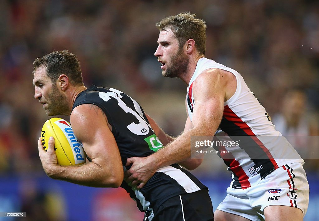Travis Cloke of the Magpies is pressured by Luke Delaney of the Saints during the round three AFL match between the Collingwood Magpies and the St Kilda Saints at the Melbourne Cricket Ground on April 17, 2015 in Melbourne, Australia.