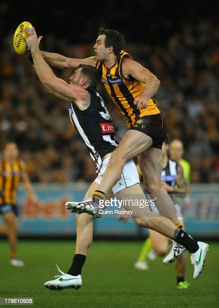 Travis Cloke of the Magpies marks infront of Brian Lake of the Hawks during the round 21 AFL match between the Hawthorn Hawks and the Collingwood...