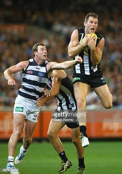 Travis Cloke of the Magpies marks infront of Steve Johnson of the Cats during the round three AFL match between the Collingwood Magpies and the...