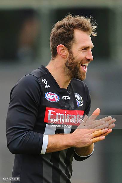 Travis Cloke of the Magpies who found himself in trouble with AFL for wearing nonapproved gloves during the game on the weekend reacts kicks the ball...