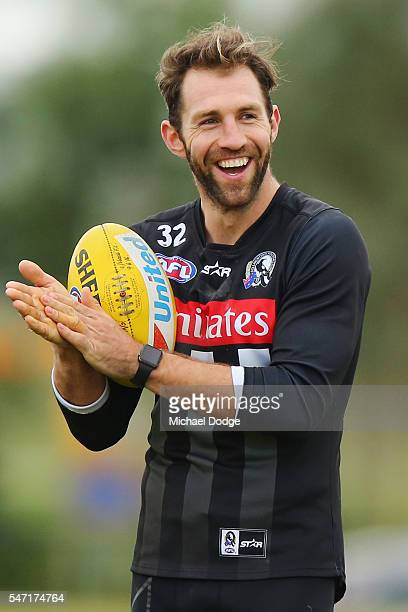 Travis Cloke of the Magpies who found himself in trouble with AFL for wearing nonapproved gloves during the game on the weekend reacts during a...