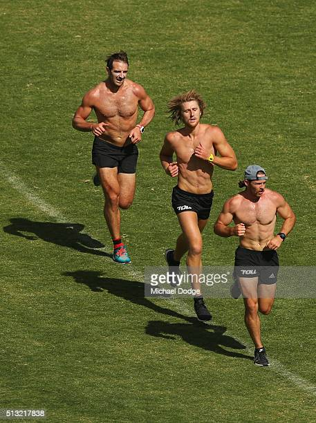 Travis Colyer leads Dyson Heppell and Jobe Watson in the last of their 1km time trials during a training session at St Bernard's College on March 2...