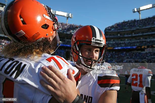 Travis Coons of the Cleveland Browns celebrates with teammates after kicking the gamewinning overtime field goal against the Baltimore Ravens at MT...
