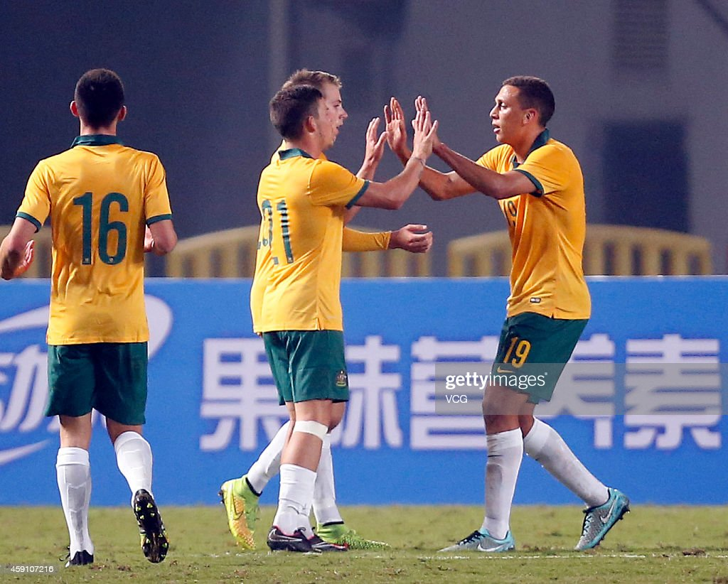 Travis Cooper #19 of Australia celebrates with team mates after scoring his team's first goal during the match between China U22 and Australia U22 on day three of the 'Wuhan City of Automobile' International Youth Football Tournament at Wuhan Sports Center Stadium on November 16, 2014 in Wuhan, China.