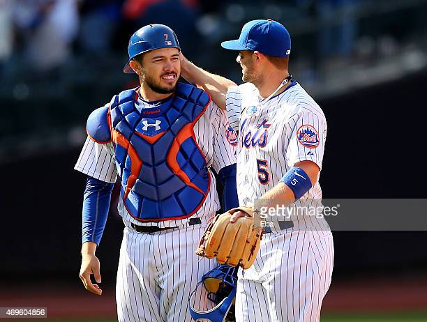 Travis d'Arnaud and David Wright of the New York Mets celebrate the win over the Philadelphia Phillies during Opening Day on April 13 2015 at Citi...