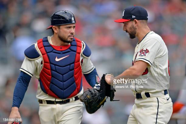 Travis d'Arnaud and Spencer Strider of the Atlanta Braves return to the dugout during a game against the New York Mets at Truist Park on October 3,...