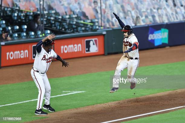 Travis d'Arnaud of the Atlanta Braves celebrates his three run homerun during the seventh inning against the Miami Marlins in Game One of the...