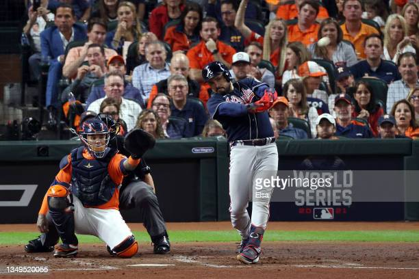 Travis d'Arnaud of the Atlanta Braves hits a one run home run against the Houston Astros during the second inning in Game Two of the World Series at...