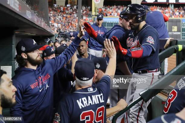 Travis d'Arnaud of the Atlanta Braves is congratulated by his teammates after hitting a one run home run against the Houston Astros during the second...