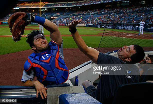 Travis d'Arnaud of the New York Mets catches a pop fly in foul territory hit by Freddie Freeman of the Atlanta Braves to end the first inning at...
