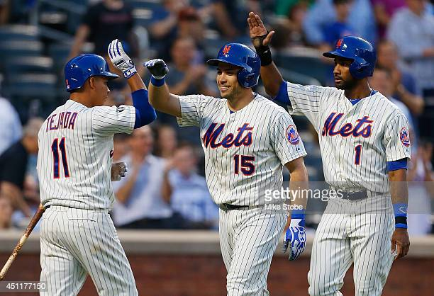 Travis d'Arnaud of the New York Mets celebrates after hitting a threerun home run in the third inning against the Oakland Athletics at Citi Field on...