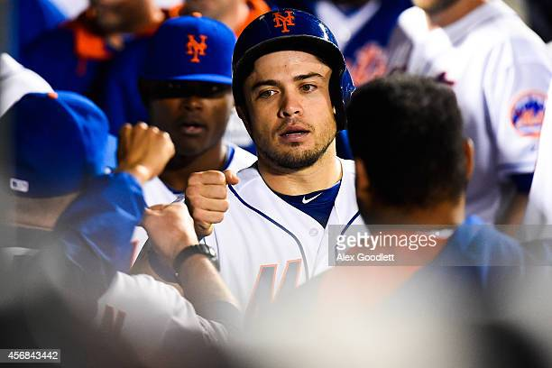 Travis d'Arnaud of the New York Mets celebrates after scoring a run during a game against the Miami Marlins on September 16 2014 at Citi Field in the...