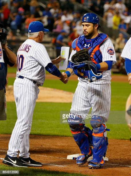 Travis d'Arnaud of the New York Mets celebrates with manager Terry Collins after defeating the Atlanta Braves at Citi Field on September 27 2017 in...