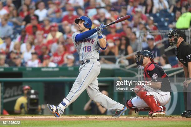 Travis d'Arnaud of the New York Mets hits a two run home run in the second inning during a baseball game against the Washington Nationals at...