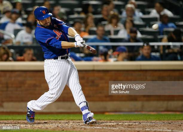 Travis d'Arnaud of the New York Mets hits an RBI double in the third inning against the Atlanta Braves during the second game of a doubleheader at...