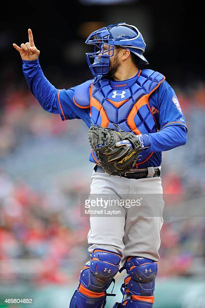 Travis d'Arnaud of the New York Mets signals two outs during a baseball game against the Washington Nationals at Nationals Park on April 9 2015 in...