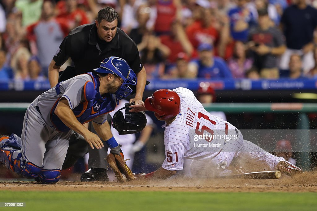 Travis d'Arnaud #18 of the New York Mets tags out Carlos Ruiz #51 of the Philadelphia Phillies at home plate in the sixth inning during a game at Citizens Bank Park on July 16, 2016 in Philadelphia, Pennsylvania.