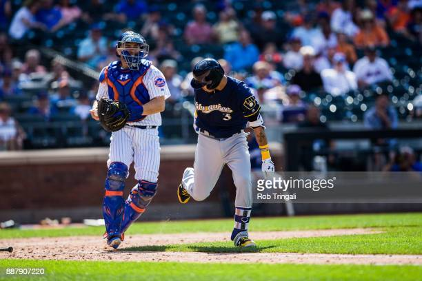 Travis d'Arnaud of the New York Mets throws to first base for the out during the game against the Milwaukee Brewers at Citi Field on Thursday June 1...