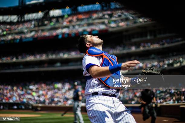 Travis d'Arnaud of the New York Mets tracks a foul ball popup during the game against the Milwaukee Brewers at Citi Field on Thursday June 1 2017 in...
