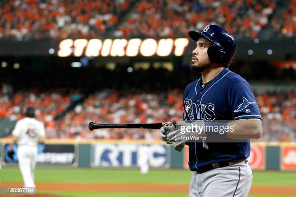Travis d'Arnaud of the Tampa Bay Rays reacts after striking out against the Houston Astros during the fourth inning in game five of the American...