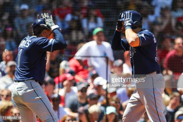 Travis d'Arnaud of the Tampa Bay Rays reacts as he crosses home pate after hitting a three-run home run in the second inning during game one of a...