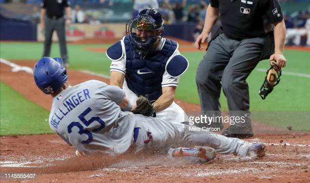 Travis d'Arnaud of the Tampa Bay Rays tags out Cody Bellinger of the Los Angeles Dodgers at home in the sixth inning at Tropicana Field on May 22...