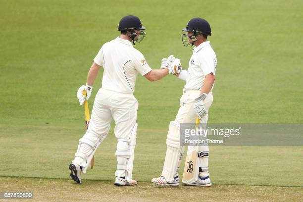 Travis Dean and Marcus Harris of the Bushrangers celebrate their hundred run partnership during the Sheffield Shield final between Victoria and South...