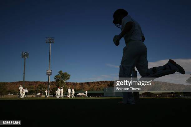 Travis Dean of the Bushrangers runs out to bat during the Sheffield Shield final between Victoria and South Australia on March 28 2017 in Alice...