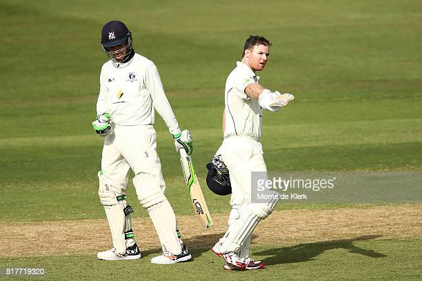 Travis Dean of the VIC Bushrangers celebrates reaching 100 runs during day 2 of the Sheffield Shield Final match between South Australia and Victoria...