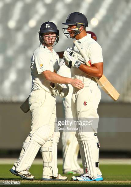 Travis Dean of Victoria is congratulated by teammate Marcus Stoinis after the winning runs were hit during day four of the Sheffield Shield match...