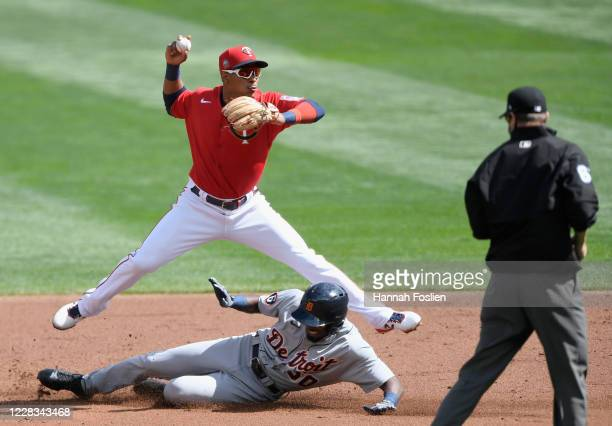 Travis Demeritte of the Detroit Tigers is out at second base as Jorge Polanco of the Minnesota Twins turns a double play during the second inning of...